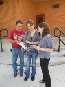 Members of the team enjoying a TLP-produced Tuncia children's book.
