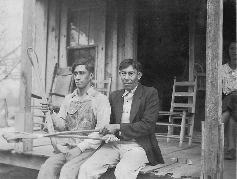 Merlin Pierite and Joseph Pierite holding stickball racquets, ca. 1930. (Photo: Frank Speck, Gregory Collection, Northwestern State University.)